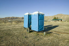Two out houses, mobile blue bathrooms, sit on trailer in the middle of a field in Ventura County, California off of highway 33 nea Stock Photo