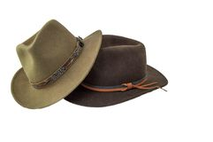 Two outback style hats one green one brown isolated on white Royalty Free Stock Photo