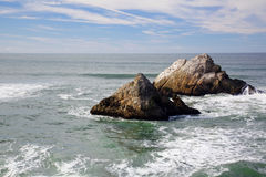 Two outcrops Ocean Shore Cliff Royalty Free Stock Photography