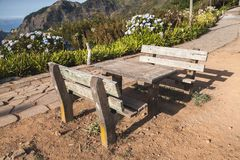 Two outdoor benches and table in Mountains royalty free stock photo