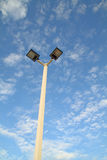 Two outdoor lamp on high pole Stock Images