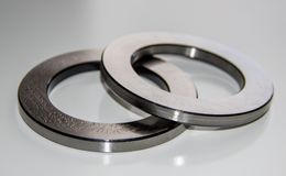 Two outer rings for a thrust roller bearing greased in bearing lubricant. With selective focus Royalty Free Stock Photography