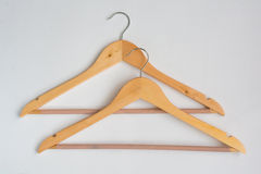 Two Over Lapping Wooden Coat Hangers Stock Photo