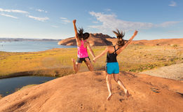 Two Overjoyed Girls Jumping Royalty Free Stock Photography