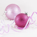Two overlapping Xmas balls with ribbons. Overlapping Xmas balls with color ribbons isolated on white background Stock Image