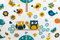 Two owls on fabric Stock Images