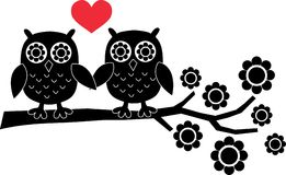 Two owls in love. Silhouette of two black owls in love Stock Photography