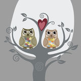 Two owls and love tree. Greeting card. This image is a vector illustration Royalty Free Stock Images