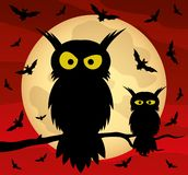 Two owls on a tree branch and bats. Two owls on a tree branch and bats on the background of the moon stock illustration