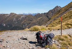 Two packed backpacks on hiking track in New Zealand. Two packed backpacks on hiking track Royalty Free Stock Images