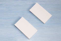 Two packs of cards are on a blue background Royalty Free Stock Image