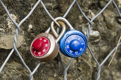 Two Padlocks Combination closed on a metal grid Stock Images