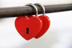 Two padlocks in the shape of hearts snapped onto the pipe royalty free stock photos
