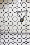 Two padlocks suspended by one chain Stock Photos