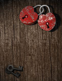Two padlocks on wood vertical. Two padlocks with together forever written as concept for eternal  love on a wood background vertical Stock Image