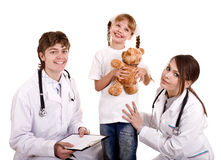 Two paediatrician treat happy child. Royalty Free Stock Image
