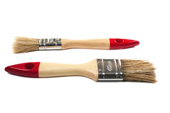 Two  paint brushes on an isolated background. With wooden handle Stock Photos