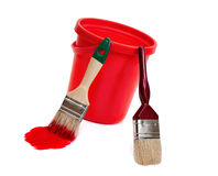 Two paint brushes and red bucket. Stock Photography