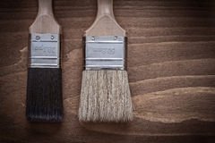 Two paint brushes with wood handles and bristle construction con Royalty Free Stock Photo