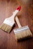 The two paint brushes on wooden background Stock Photography