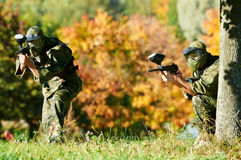 Two paintball players Stock Images