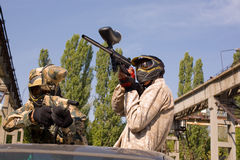 Two paintball players. In camouflage uniform, outdoors royalty free stock photos