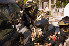 Two paintball players. Beside a car royalty free stock photo