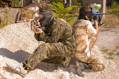 Two paintball players in action. Outdoors stock images