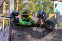 Two paintball shooters defending wooden tower Royalty Free Stock Photography