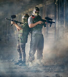 Two paintball shooters Royalty Free Stock Images
