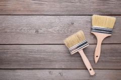 Two paintbrush on a grey wooden background stock photos