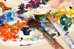 Two paintbrush and strokes of oil paints Royalty Free Stock Image
