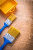 Two paintbrushes with blue handles and yellow Royalty Free Stock Photography