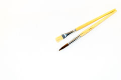 Two paint brushes. Isolated on a white background Stock Photos