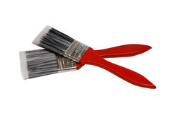 Two paintbrushes with red handles Royalty Free Stock Photography