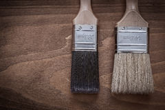 Two paintbrushes with wood handles and bristle horizontal versio Royalty Free Stock Images
