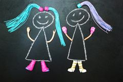 Two painted doll with pigtails on a black background royalty free illustration