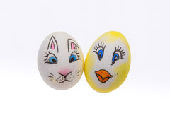 Two painted Easter eggs on a white background. Two painted Easter eggs, one with an Easter bunny and one with chicken, on a white background Stock Photos