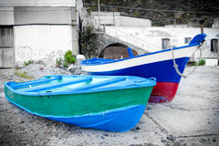Two painted old boats. Somewhere in Sicily Italy Europe stock images