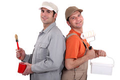 Two painters back to back. Studio shot Royalty Free Stock Photo