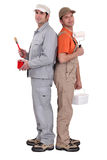 Two painters back to back. Against a white background Stock Image