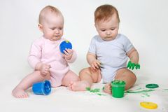 Two painting babies Stock Images