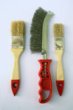 Two painting brushes and abrasive brush in the middle. 1 Royalty Free Stock Photo