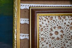 Two paintings crocheted with white threads in vintage wooden frames royalty free stock photography