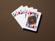 Two pair. Five playcards with two pairs laying on a brown table Royalty Free Stock Photos