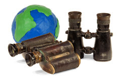Two pair of binoculars and a globe Stock Photography