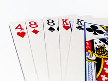 Two Pair Card in Poker Game with White Background. A playing card is a piece of specially prepared heavy paper, thin cardboard, plastic-coated paper, cotton Royalty Free Stock Photo