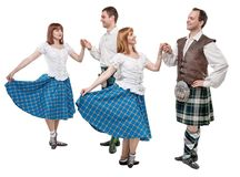 Two pair of dancers of Scottish dance. Isolated Royalty Free Stock Images