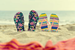Two pair of flip-flops on the beach Stock Photography