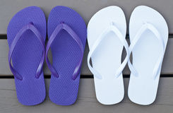 Two Pair of Flip Flops on the Deck Royalty Free Stock Photography